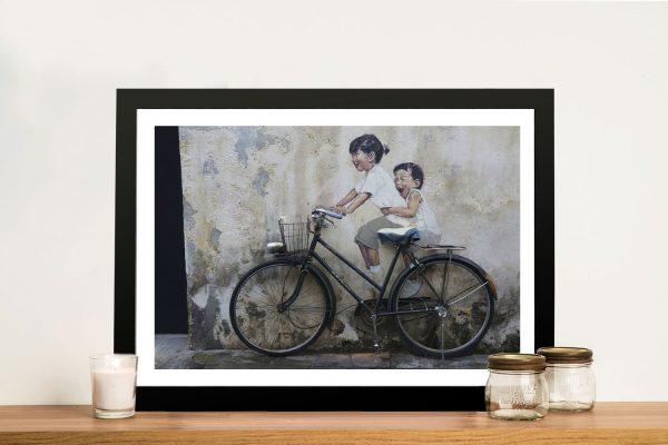 Buy a Banksy Graffiti Print of Kids on a Bike