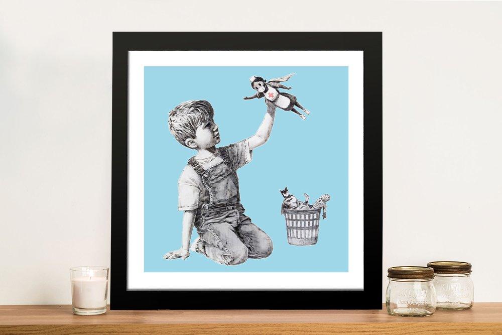 Framed Blue Banksy Print of Superhero Nurse