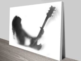 shadowed guitarist art photo to stretched canvas
