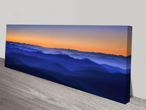 blue orange sunset hills wall art